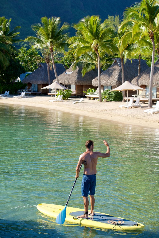 https://tahititourisme.ca/wp-content/uploads/2019/01/Paddle-boarding-in-the-lagoon-at-Manava-Beach-Resort-Spa-Moorea.jpg